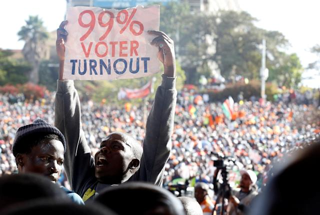 <p>A supporter of Kenyan opposition National Super Alliance (NASA) coalition's Presidential candidate Raila Odinga displays a placard during their final campaign rally at the Uhuru park grounds in Nairobi, Kenya, Aug. 5, 2017. (Photo: Thomas Mukoya/Reuters) </p>