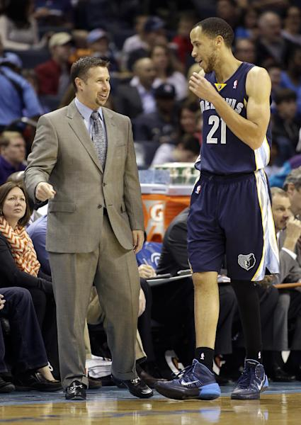 Memphis Grizzlies' head coach David Joerger talks with Tayshaun Prince (21) from the sidelines during the first half of an NBA basketball game against the Charlotte Bobcats in Charlotte, N.C., Saturday, Feb. 22, 2014. (AP Photo/Bob Leverone)