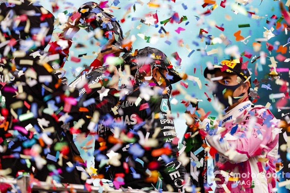 "Lewis Hamilton, Mercedes-AMG F1, celebrates on the podium after winning the race, to take his 7th World Championship title, with Sergio Perez, Racing Point, 2nd position, <span class=""copyright"">Charles Coates / Motorsport Images</span>"