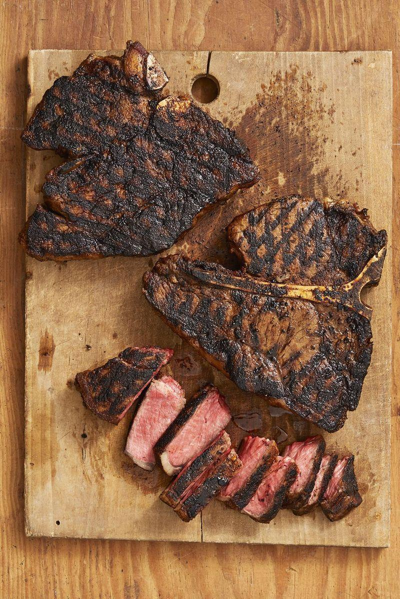 """<p>Ree prefers to grill steaks like this inside, using a grill pan—because she likes air conditioning!</p><p><strong><a href=""""https://www.thepioneerwoman.com/food-cooking/recipes/a32905916/cajun-t-bone-steaks-recipe/"""" rel=""""nofollow noopener"""" target=""""_blank"""" data-ylk=""""slk:Get the recipe."""" class=""""link rapid-noclick-resp"""">Get the recipe.</a></strong></p><p><a class=""""link rapid-noclick-resp"""" href=""""https://go.redirectingat.com?id=74968X1596630&url=https%3A%2F%2Fwww.walmart.com%2Fip%2FThe-Pioneer-Woman-Timeless-Beauty-Pre-Seasoned-Plus-20-Cast-Iron-Double-Griddle%2F117723541&sref=https%3A%2F%2Fwww.thepioneerwoman.com%2Ffood-cooking%2Fmeals-menus%2Fg32188535%2Fbest-grilling-recipes%2F"""" rel=""""nofollow noopener"""" target=""""_blank"""" data-ylk=""""slk:SHOP GRIDDLES"""">SHOP GRIDDLES</a></p>"""