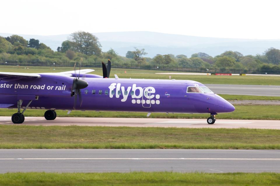 Manchester, United Kingdom - May 8, 2016: Flybe Bombardier Dash 8 Q400 twin-engine, medium range, turboprop passenger plane taxiing on Manchester International Airport tarmac.