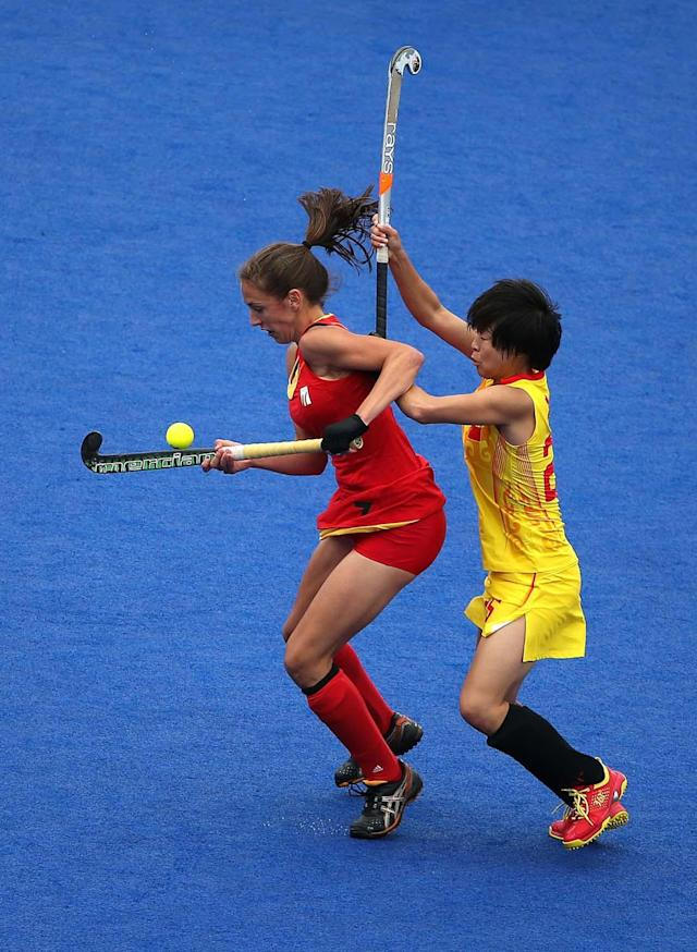 LONDON, ENGLAND - JULY 31: Judith Vandermeiren (L) of Belgium and Xiaoxu Xu of China eye the ball during the Women's Hockey Match between Belgium and China on day 4 of the London 2012 Olympic Games at Hockey Centre on July 31, 2012 in London, England. (Photo by Daniel Berehulak/Getty Images)