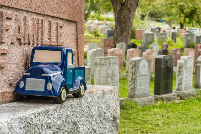 """<span class=""""caption"""">A toy truck left at a tombstone in a Montreal cemetery.</span> <span class=""""attribution""""><a class=""""link rapid-noclick-resp"""" href=""""https://www.shutterstock.com/image-photo/blue-car-toy-on-tombstone-montreal-388131745?src=5n1HEqnPnzGZ-H8Scg1g8w-1-25"""" rel=""""nofollow noopener"""" target=""""_blank"""" data-ylk=""""slk:Marc Bruxelle/Shutterstock.com"""">Marc Bruxelle/Shutterstock.com</a></span>"""