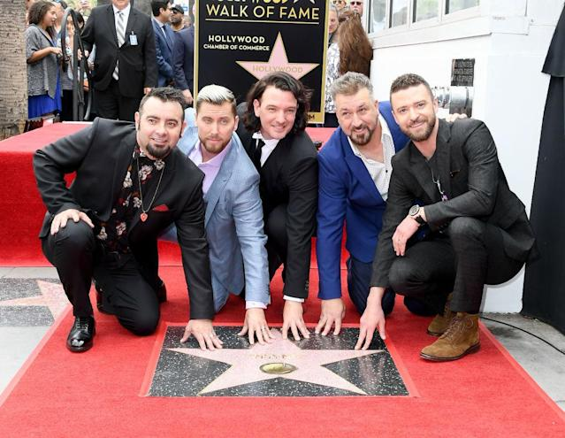 NSync — Chris Kirkpatrick, Lance Bass, JC Chasez, Joey Fatone, and Justin Timberlake — reunite for their Hollywood Walk of Fame ceremony. (Photo: Steve Granitz/WireImage)