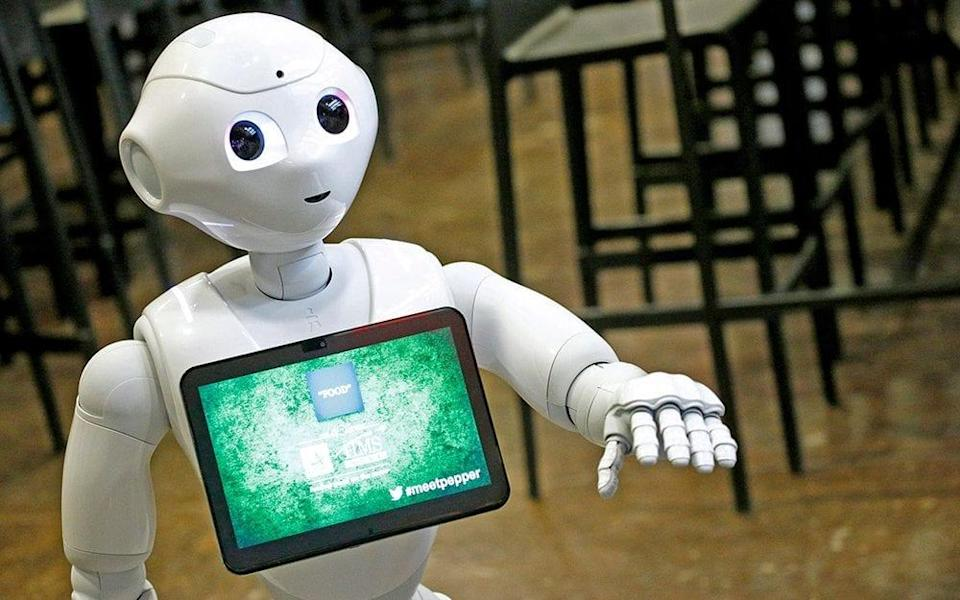 Reaching for your pay packet: Computers and robots are taking tasks from workers, making their jobs simpler and undermining their earning power - 2017 Getty Images