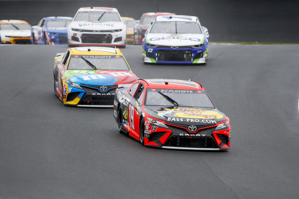 Martin Truex Jr. (19) competes in a NASCAR Cup Series auto race at Charlotte Motor Speedway in Concord, N.C., Sunday, Oct. 11, 2020. (AP Photo/Nell Redmond)