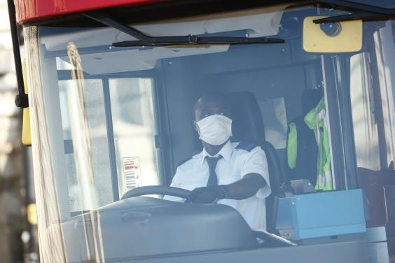 Bus drivers are among those who do not have to self-isolate after travelling abroad (AFP via Getty)