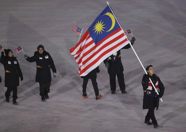 <p>Julian Zhi Jie Yee carries the flag of Malaysia, during the opening ceremony of the 2018 Winter Olympics in Pyeongchang, South Korea, Friday, Feb. 9, 2018. (AP Photo/Michael Sohn) </p>