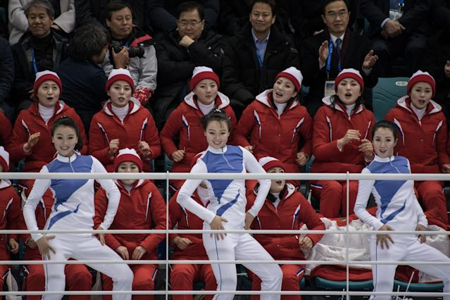 <p>North Korean cheerleaders perform during the women's preliminary round ice hockey match between the unified Korea team loose to Switzerland at the Pyeongchang 2018 Winter Olympics, at the Gangneung Ice Arena in Gangneung on February 10, 2018. </p>