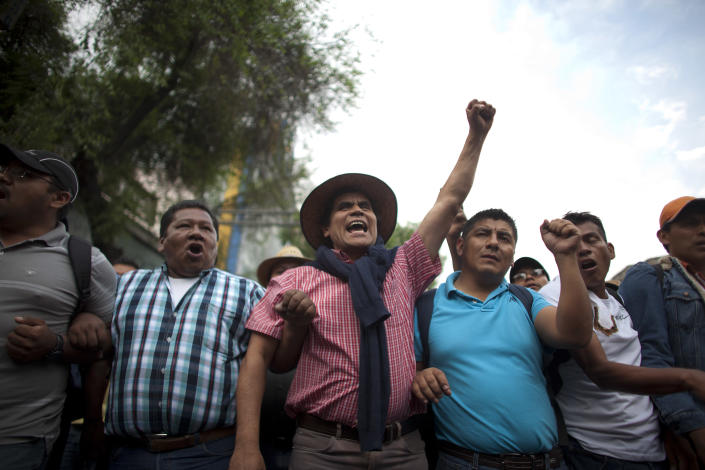 Public school teachers shout slogans while protesting in Mexico City, Thursday, April 4, 2013. Radical Mexican public school teachers are holding marches and blocking roads to battle a newly enacted education reform that would weaken union powers. (AP Photo/Alexandre Meneghini)