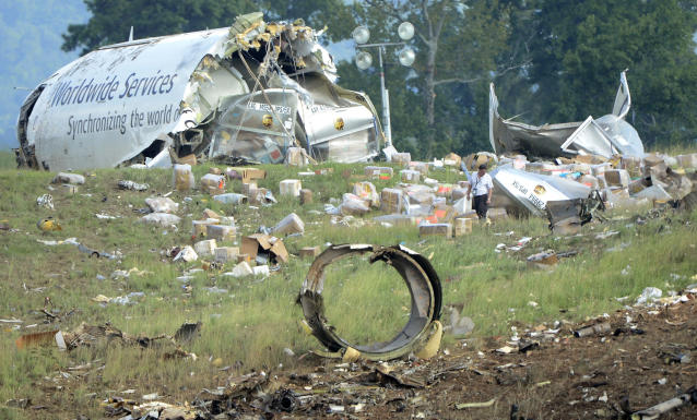 An investigator works near a section of debris of a UPS Airbus A300 cargo plane after it crashed on approach at Birmingham-Shuttlesworth International Airport, Wednesday Aug. 14, 2013 in Birmingham, Ala. The two pilots aboard the aircraft were killed. (AP Photo/AL.com, Mark Almond) MAGS OUT