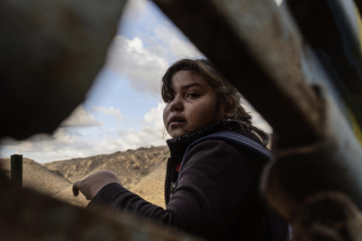 Mirna-Marely, shown at age 10, from Honduras cries after she crosses the border between Mexico and the U.S., Dec. 1, 2018. (Photo: Fabio Bucciarelli for Yahoo News)
