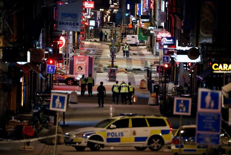 The scene in Stockholm on April 7, 2017 after a truck mowed down pedestrians on a busy street and slammed into a department store, killing five people