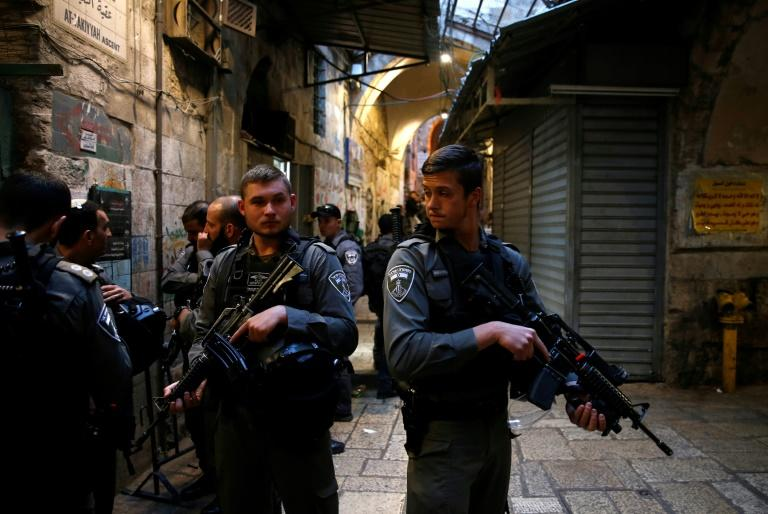 Israeli security forces stand guard at the site of a stabbing attack by a Palestinian assailant, who was shot dead, in Jerusalem's Old City on March 18, 2018
