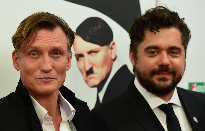 German actor Oliver Masucci and director David Wnendt (R) pose on the red carpet before the World Premiere screening of the movie 'Er ist wieder da' (He's back) at the cinema Zoo Palast on October 6, 2015 in Berlin (AFP Photo/John MacDougall)