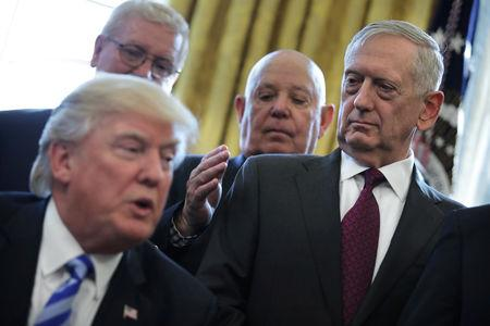 FILE PHOTO: U.S. Defense Secretary James Mattis looks at U.S. President Donald Trump as he speaks during a meeting with Medal of Honor recipients in the Oval Office of the White House in Washington, U.S., March 24, 2017. REUTERS/Carlos Barria/File Photo