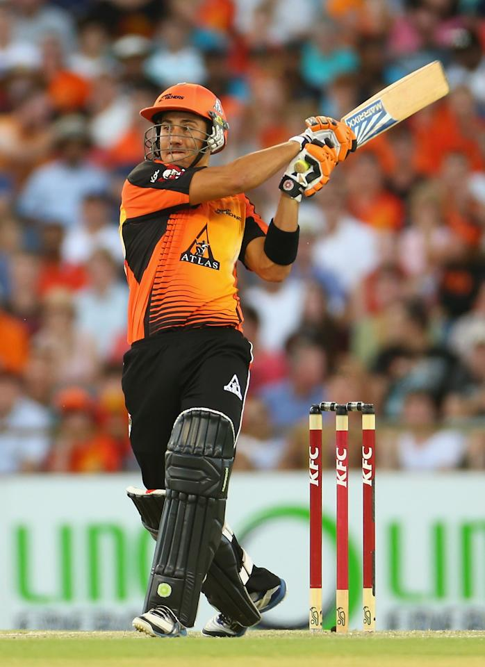 PERTH, AUSTRALIA - JANUARY 19: Marcus Stoinis of the Scorchers hits out during the Big Bash League final match between the Perth Scorchers and the Brisbane Heat at the WACA on January 19, 2013 in Perth, Australia.  (Photo by Robert Cianflone/Getty Images)