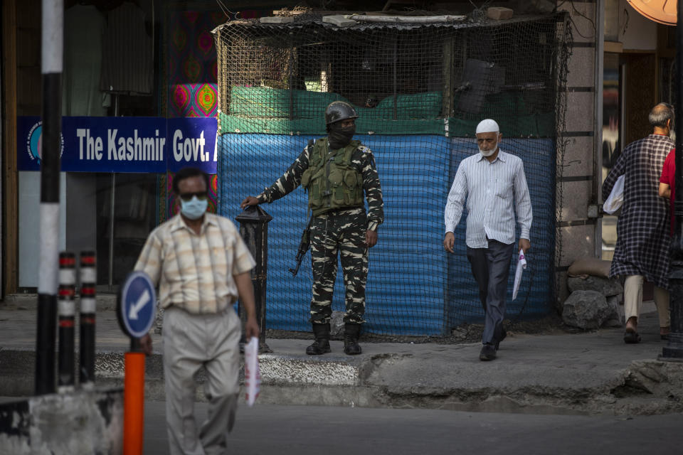 An Indian paramilitary soldier stands guard outside his post in Srinagar, Indian controlled Kashmir, Tuesday, Aug. 24, 2021. Indian government forces killed two senior rebel commanders and three other militants in two separate counterinsurgency operations in disputed Kashmir, police said Tuesday. (AP Photo/Mukhtar Khan)