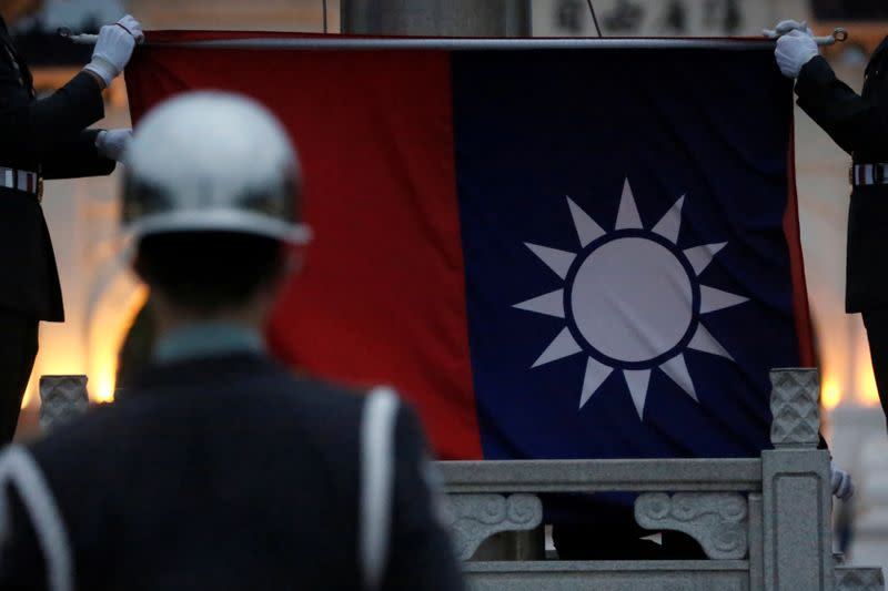 Honor guards perform Taiwan national flag lowering ceremony at Liberty Square in Taipei,