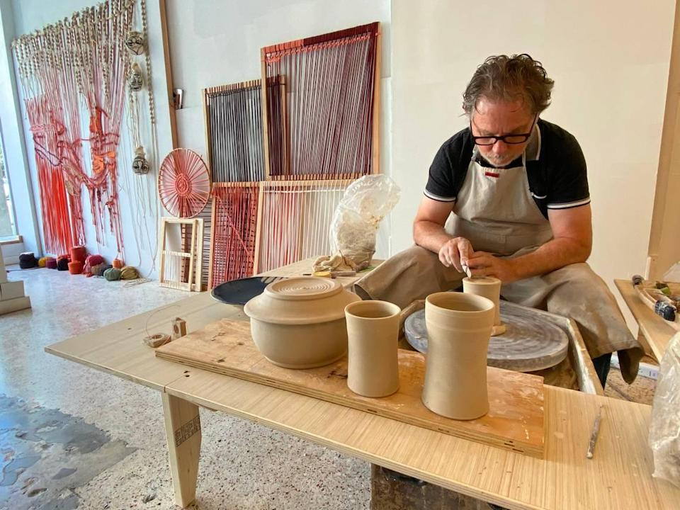 Empty spaces along Coral Gables' Miracle Mile have been filled this December with studios of working artists, including James Herring.