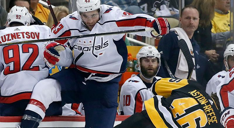 Tom Wilson hits Pittsburgh's Zach Aston-Reese. More