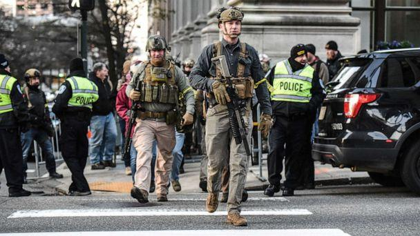 PHOTO: People who are part of an armed militia group walk near the Virginia State Capitol building to advocate for gun rights in Richmond, Va., Jan. 20, 2020. (Stephanie Keith/Reuters)