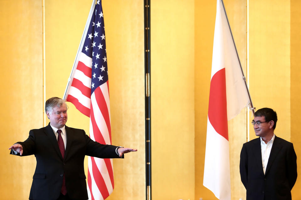 U.S. Deputy Secretary of State Stephen Biegun, left, and Japan's Defense Minister Taro Kono pose for a photo session prior to their bilateral meeting in Tokyo Friday, July 10, 2020. (Behrouz Mehri/Pool Photo via AP)