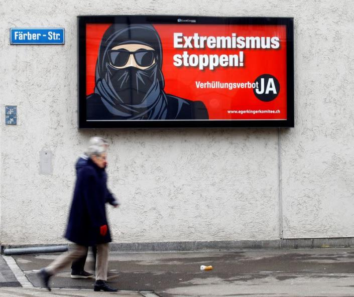 FILE PHOTO: A poster of the initiative committee against wearing the burqa is seen in Zurich