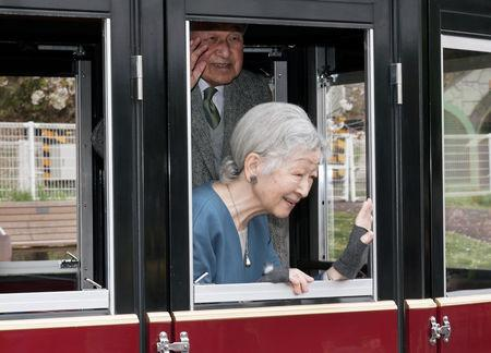 Japan's Emperor Akihito, top, and Empress Michiko, bottom, react to the well-wishers as they visit Kodomonokuni, or Children's Land, marking the 60th anniversary of the royal marriage of Emperor Akihito and Empress Michiko in Yokohama