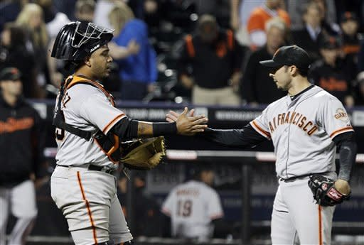 San Francisco Giants' Clay Hensley, right, celebrates with teammate Hector Sanchez after the last out of a baseball game against the New York Mets, Friday, April 20, 2012, in New York. The Giants won the game 4-3. (AP Photo/Frank Franklin II)