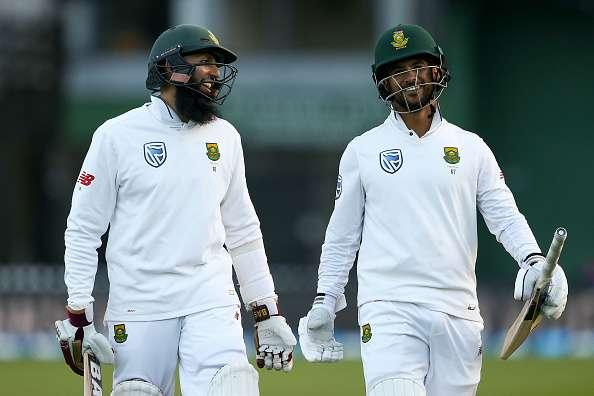 WELLINGTON, NEW ZEALAND - MARCH 18: Hashim Amla and JP Duminy of South Africa celebrate the win during day three of the test match between New Zealand and South Africa at Basin Reserve on March 18, 2017 in Wellington, New Zealand. (Photo by Hagen Hopkins/Getty Images)
