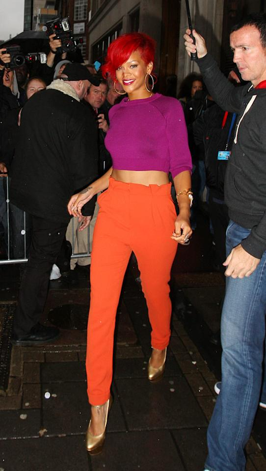 "The princess of pop strikes again, this time in a garish getup consisting of a belly-baring fuchsia sweater, high-waisted tangerine trousers, and gold platform pumps. Clown-like locks complete her catastrophic look. Gotcha Images/<a href=""http://www.splashnewsonline.com"" target=""new"">Splash News</a> - October 1, 2010"