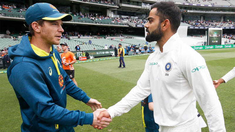 Tim Paine shakes hands with Virat Kohli after the match.