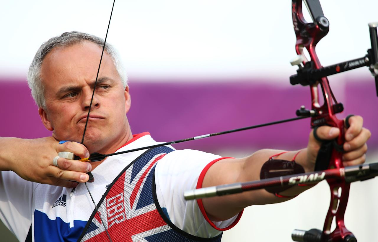 LONDON, ENGLAND - JULY 27: Simon Terry of Great Britain prepares to arch during the Archery Ranking Round on Olympics Opening Day as part of the London 2012 Olympic Games at the Lord's Cricket Ground on July 27, 2012 in London, England.  (Photo by Paul Gilham/Getty Images)
