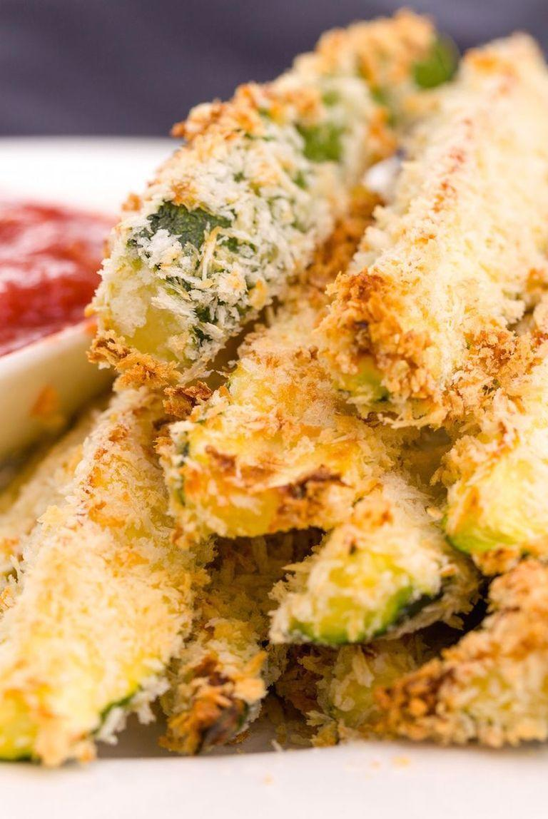 """<p>A light coating of Panko bread crumbs and 20 minutes in the oven transforms thick slices of courgette into everyone's favourite finger food.</p><p>Get the <u><a href=""""https://www.delish.com/uk/cooking/recipes/a28961565/zucchini-fries-recipe/"""" rel=""""nofollow noopener"""" target=""""_blank"""" data-ylk=""""slk:Courgette Fries"""" class=""""link rapid-noclick-resp"""">Courgette Fries</a> </u>recipe.</p>"""
