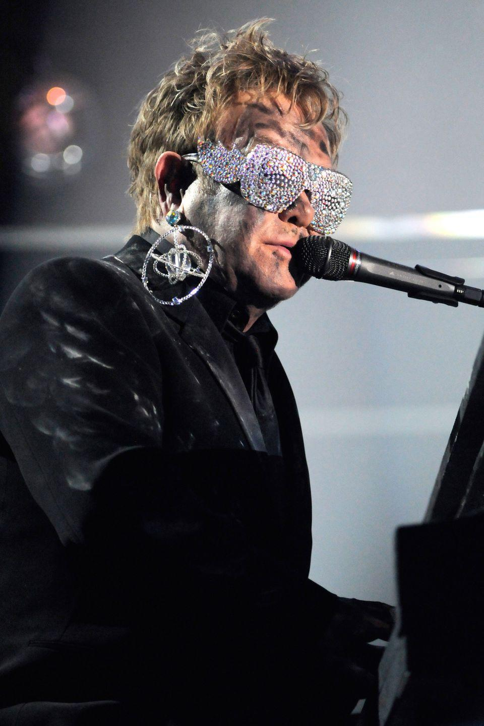 <p>Elton John never shies away from a bold look, especially when it involves his glasses. From rose tinted shades to ones with full-on bedazzling, the singer's favorite accessory always steals the show. </p>