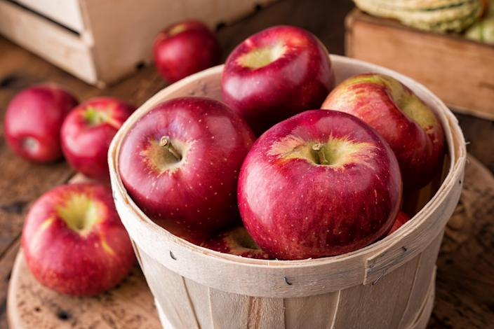 Apples are rich in antioxidants and fibre, but only if eaten whole, not juiced. [Photo: Getty]