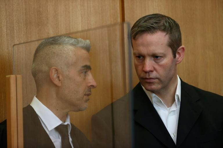 "Ernst (R with his lawyer Mustafa Kaplan) said he had carried out a ""cowardly and cruel"" act"