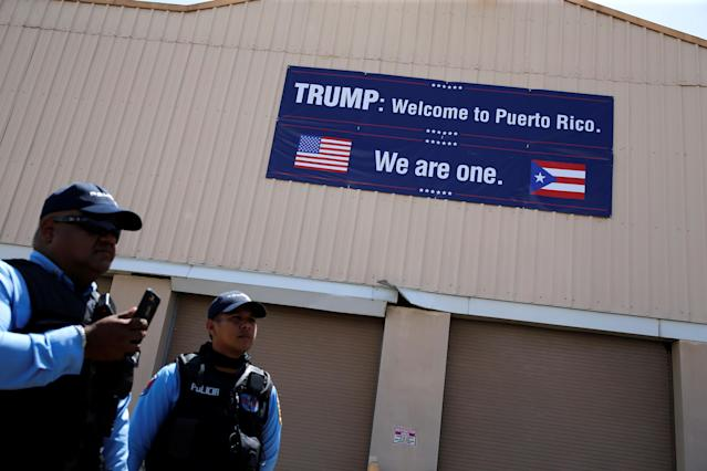 <p>Local police greet President Donald Trump and first lady Melania Trump as they arrive aboard Air Force One, to survey hurricane damage, at Muniz Air National Guard Base in Carolina, Puerto Rico, Oct. 3, 2017. (Photo: Jonathan Ernst/Reuters) </p>