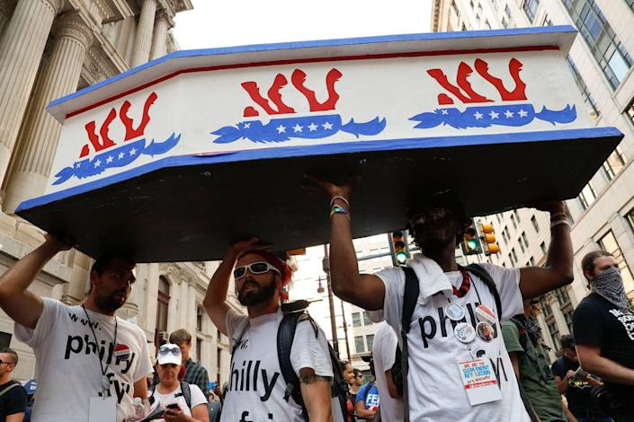 <p>Supporters of Sen. Bernie Sanders march near City Hall in Philadelphia, Tuesday, July 26, 2016, during the second day of the Democratic National Convention. (Photo: John Minchillo/AP)</p>