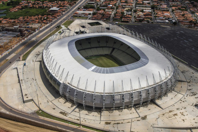 This March 13, 2014 photo released by Portal da Copa shows an aerial view of the Castelao stadium in Fortaleza, Brazil. Castelao will host matches during the 2014 World Cup soccer tournament. (AP Photo/Fabio Lima, Portal da Copa)