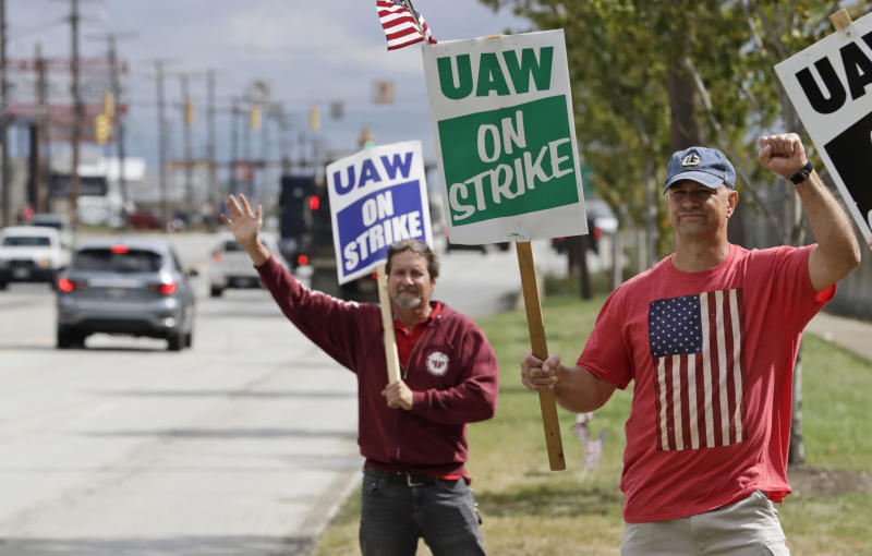 Bob Pevec, right, a 20-year GM employee, pickets outside the General Motors Fabrication Division, Monday, Sept. 23, 2019, in Parma, Ohio. Pevec is a tool and die maker. The strike against General Motors by 49,000 United Auto Workers entered its second week Monday with progress reported in negotiations but no clear end in sight. (AP Photo/Tony Dejak)