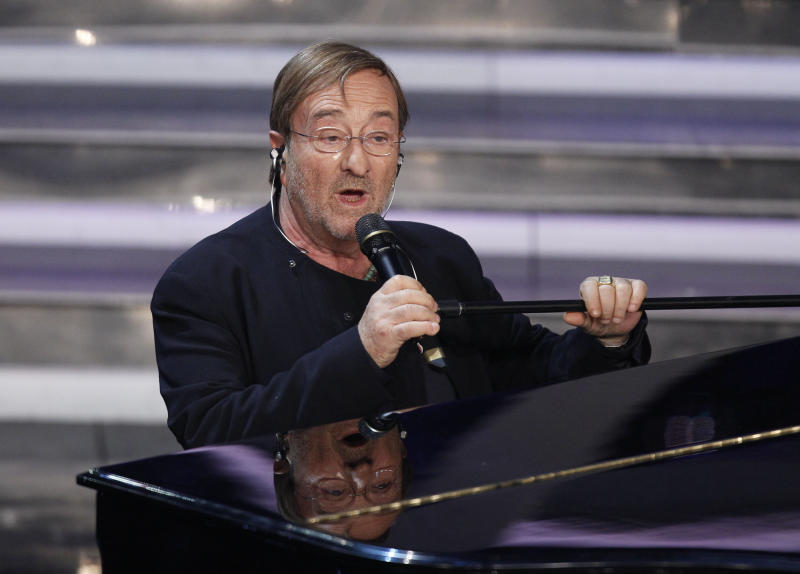 FILE - In this Thursday, Feb. 16, 2012 file photo, Italian singer Lucio Dalla performs during the 62nd edition of the Sanremo Song Festival, in Sanremo, Italy. Lucio Dalla died of a heart attack, aged 68 in Montreaux, Switzerland, Thursday, March 1, 2012. (AP Photo/Luca Bruno, file)