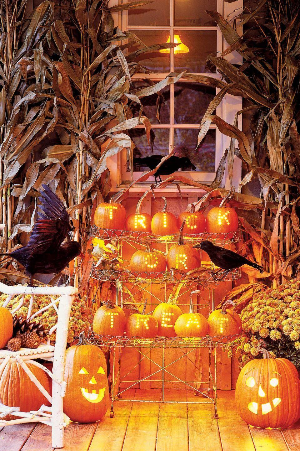 """<p class=""""imageContent"""">Spell out your greeting in mini pumpkins gathered on your porch.</p><p><strong>Step 1:</strong> Pencil letters on hollowed pumpkins (carve out the opening from the bottom).</p><p><strong>Step 2:</strong> Using a drill with a half-inch bit, bore holes to form each letter.</p><p><strong>Step 3:</strong> Hang strings of Christmas-tree lights, gathered in small bunches, to illuminate each pumpkin (unscrew bulbs where the string descends to the next row). </p>"""