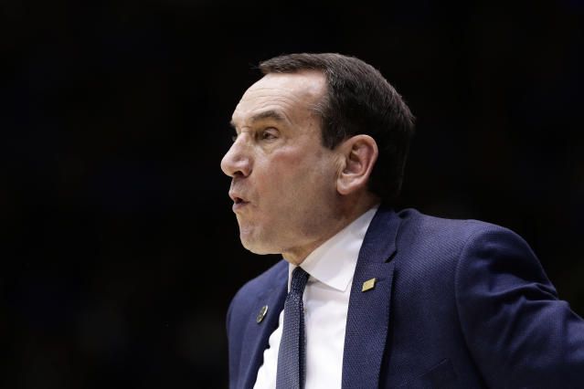 Duke coach Mike Krzyzewski directs his team during the first half of an NCAA college basketball game against Louisville in Durham, N.C., Saturday, Jan. 18, 2020. (AP Photo/Gerry Broome)