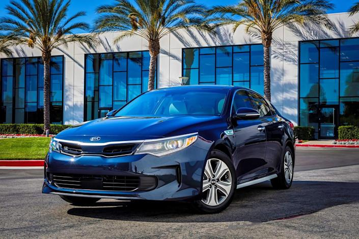"""<p>A few styling updates and more standard safety features <a href=""""https://www.caranddriver.com/news/a19621935/2019-kia-optima-photos-and-info-news/"""" rel=""""nofollow noopener"""" target=""""_blank"""" data-ylk=""""slk:added for 2019"""" class=""""link rapid-noclick-resp"""">added for 2019</a> make <a href=""""https://www.caranddriver.com/kia/optima"""" rel=""""nofollow noopener"""" target=""""_blank"""" data-ylk=""""slk:the Kia Optima Hybrid"""" class=""""link rapid-noclick-resp"""">the Kia Optima Hybrid</a> an even better buy than last year's version. We like the way this hybrid disguises its gas-electric drivetrain with its smooth operation (you'd never know it is a hybrid), and its 41-mpg EPA rating is solid—even if it lags behind the competition.<br></p>"""