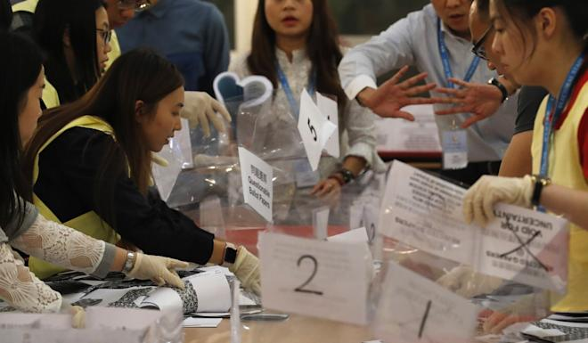 Some of the 2.94 million votes are counted at a polling station for the first Hong Kong elections since the protest crisis broke out in June. Photo: EPA-EFE