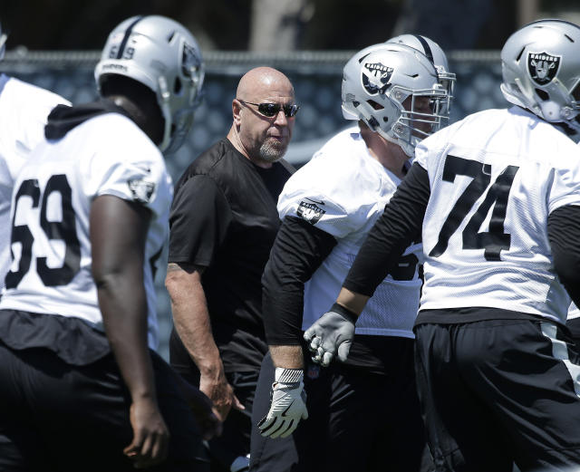FILE - In this June 13, 2018, file photo, Oakland Raiders offensive line coach Tom Cable calls out instructions at the NFL football team's minicamp in Alameda, Calif. Nearly eight years after being fired as head coach of the Oakland Raiders, Tom Cable is back with the team as offensive line coach. (AP Photo/Rich Pedroncelli, File)