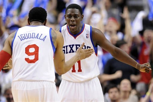 Philadelphia 76ers' Jrue Holiday (11) celebrates with Andre Iguodala (9) after he scored a 3-pointer against the Chicago Bulls during the second half of Game 4 in a first-round NBA basketball playoff series in Philadelphia, Sunday, May 6, 2012. The 76ers won 89-82. (AP Photo/Michael Perez)