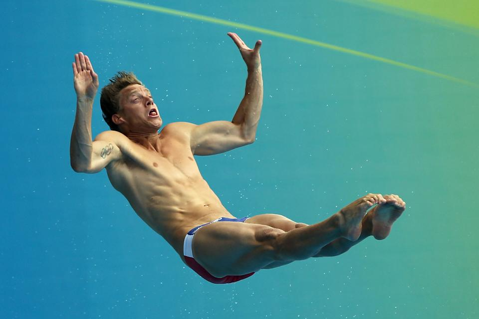SHANGHAI, CHINA - JULY 18: Chris Colwill of the United States competes in the Men's 1m Springboard Final during Day Three of the 14th FINA World Championships at the Oriental Sports Center on July 18, 2011 in Shanghai, China. (Photo by Ezra Shaw/Getty Images)